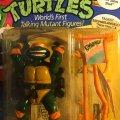 "Talkin' Michelangelo - ""Pizza Time!"" & ""Kowabunga!""   Teenage Mutant Ninja Turtles (World's First Talking Mutant Figures!) - Playmates Toys 1991 фото-2"